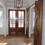 Magnificent foyer featuring hardwood floors and barn doors | Richmond, VA