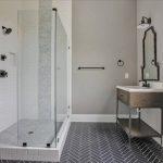 Dark herringbone tile on floor and light tile in shower, near Glen Allen, VA